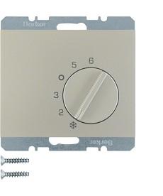Regulator temperatury pomieszczenia z zestykiem zmiennym i elementem centralnym;
